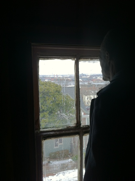 William Alston-El looking out an Anacostia attic at Washington City, February 2014.